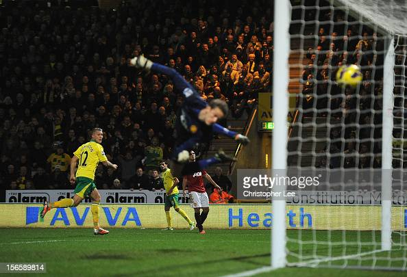 Anthony Pilkington of Norwich City scores his opening goal past goalkeeper Anders Lindegaard of Manchester United during the Barclays Premier League...