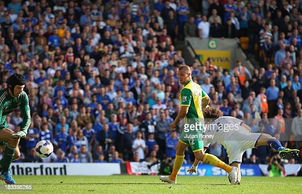 Anthony Pilkington of Norwich City scores their first goal past Petr Cech of Chelsea during the Barclays Premier League match between Norwich City...