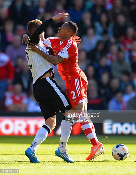 Anthony Pilkington of Norwich City tussles with Nathaniel Clyne of Southampton during the Barclays Premier League match between Southampton and...