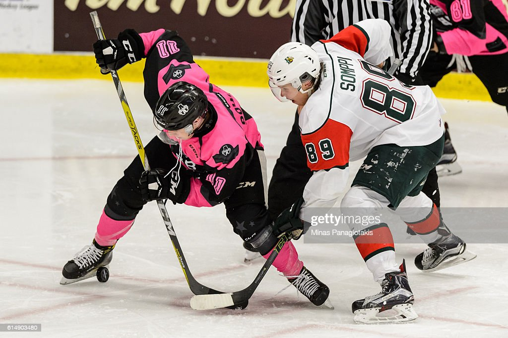 Anthony Poulin #11 of the Blainville-Boisbriand Armada and Otto Somppi #89 of the Halifax Mooseheads take a face-off during the QMJHL game at the Centre d'Excellence Sports Rousseau on October 15, 2016 in Boisbriand, Quebec, Canada. The Blainville-Boisbriand Armada defeated the Halifax Mooseheads 4-2.