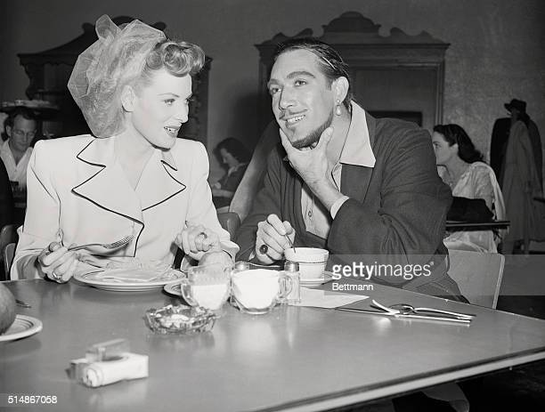 Anthony Quinn thinking as he lunches with Maureen O'Hara on the set of Sinbad the Sailor at RKO studios in 1946 For their roles in the film the...
