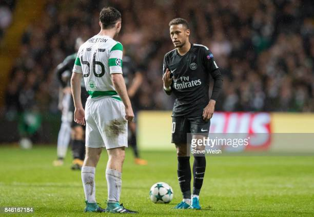 Anthony Ralston of Celtic has words with Neymar of Paris Saint Germain who raises three fingers to show the current score of Paris Saint Germain...