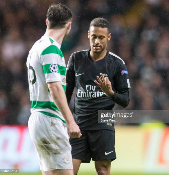 Anthony Ralston of Celtic has words with Neymar of Paris Saint Germain who raises three fingers to show the current score of Paris Saint Germain...