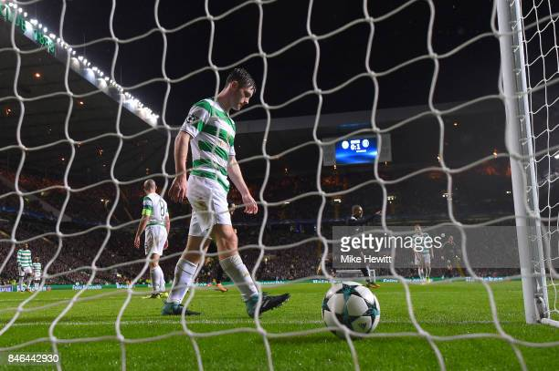 Anthony Ralston of Celtic looks dejected as Kylain Mbappe of Paris Saint Germain celebrates his goal during the UEFA Champions League Group B match...