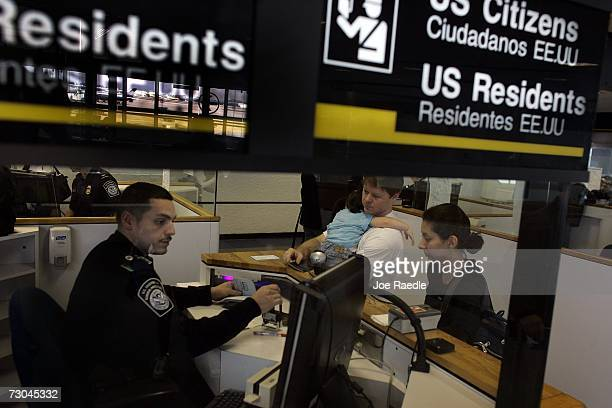 Anthony Ramos a Customs and Border Protection officer checks Chris Layman Katy Layman 21 mths old and Natalie Layman in at the passport control area...