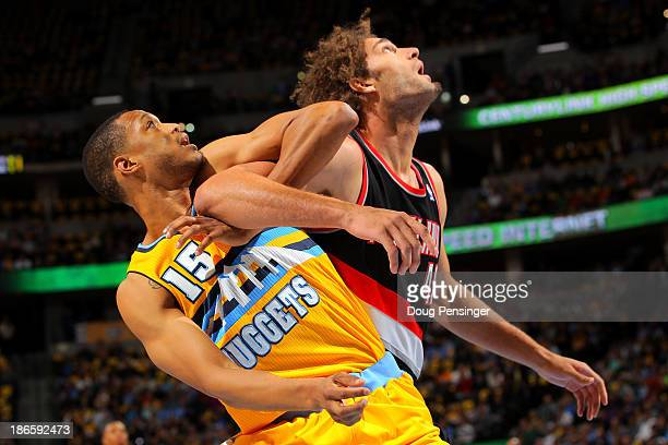 Anthony Randolph of the Denver Nuggets and Robin Lopez of the Portland Trail Blazers battle for rebounding position at Pepsi Center on November 1...