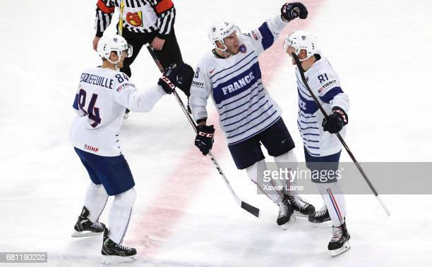 Anthony Rech of France celebrate his goal with Kevin Hecquefeuille and Yohann Auvitu during the 2017 IIHF Ice Hockey World Championship game between...