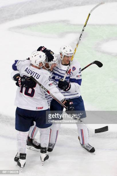 Anthony Rech of France celebrates his goal with Yohann Auvitu and Kevin Hecquefeuille of France during the 2017 IIHF Ice Hockey World Championship...