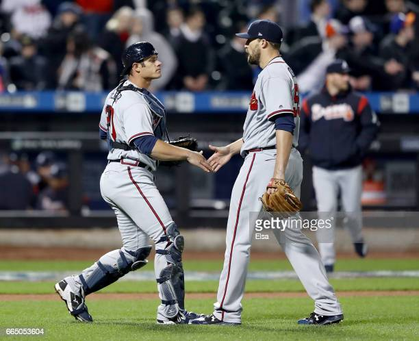 Anthony Recker and Jim Johnson of the Atlanta Braves celebrate the 31 win over the New York Mets in the 12th inning on April 5 2017 at Citi Field in...