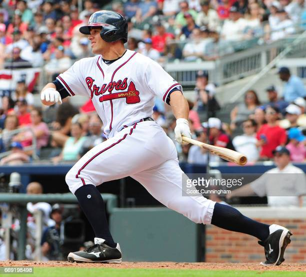Anthony Recker of the Atlanta Braves hits an eighth inning single against the San Diego Padres at SunTrust Park on April 16 2017 in Atlanta Georgia