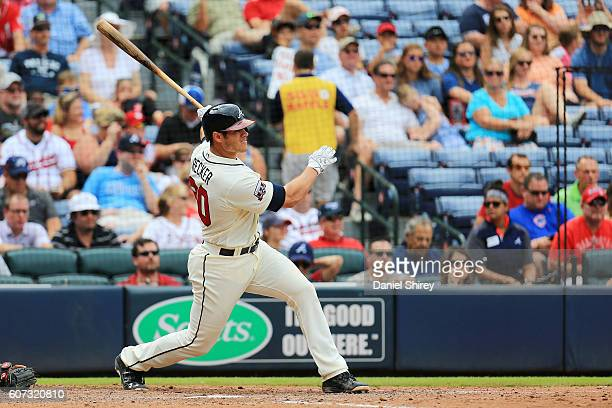 Anthony Recker of the Atlanta Braves hits an RBI single in the fifth inning against the Washington Nationals at Turner Field on September 17 2016 in...