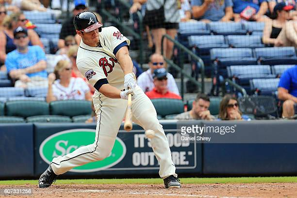 Anthony Recker of the Atlanta Braves hits an RBI single in the seventh inning against the Washington Nationals at Turner Field on September 17 2016...