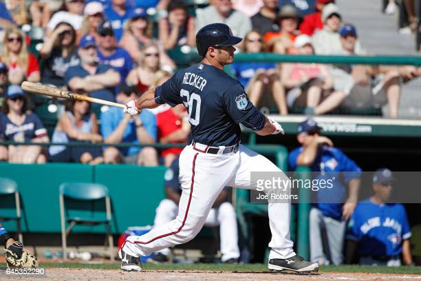 Anthony Recker of the Atlanta Braves singles in a pair of runs in the fifth inning against the Toronto Blue Jays during the spring training game at...