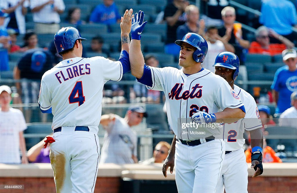 Anthony Recker #20 of the New York Mets celebrates his sixth inning three-run home run against the Philadelphia Phillies with teammates <a gi-track='captionPersonalityLinkClicked' href=/galleries/search?phrase=Dilson+Herrera&family=editorial&specificpeople=11264584 ng-click='$event.stopPropagation()'>Dilson Herrera</a> #2 and <a gi-track='captionPersonalityLinkClicked' href=/galleries/search?phrase=Wilmer+Flores&family=editorial&specificpeople=5970686 ng-click='$event.stopPropagation()'>Wilmer Flores</a> #4 at Citi Field on August 31, 2014 in the Flushing neighborhood of the Queens borough of New York City.