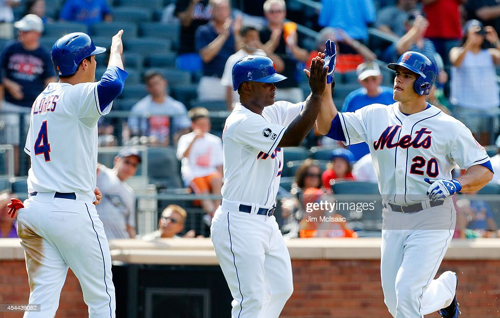 Anthony Recker #20 of the New York Mets celebrates his sixth inning three run home run against the Philadelphia Phillies with teammates <a gi-track='captionPersonalityLinkClicked' href=/galleries/search?phrase=Dilson+Herrera&family=editorial&specificpeople=11264584 ng-click='$event.stopPropagation()'>Dilson Herrera</a> #2 and <a gi-track='captionPersonalityLinkClicked' href=/galleries/search?phrase=Wilmer+Flores&family=editorial&specificpeople=5970686 ng-click='$event.stopPropagation()'>Wilmer Flores</a> #4 at Citi Field on August 31, 2014 in the Flushing neighborhood of the Queens borough of New York City.