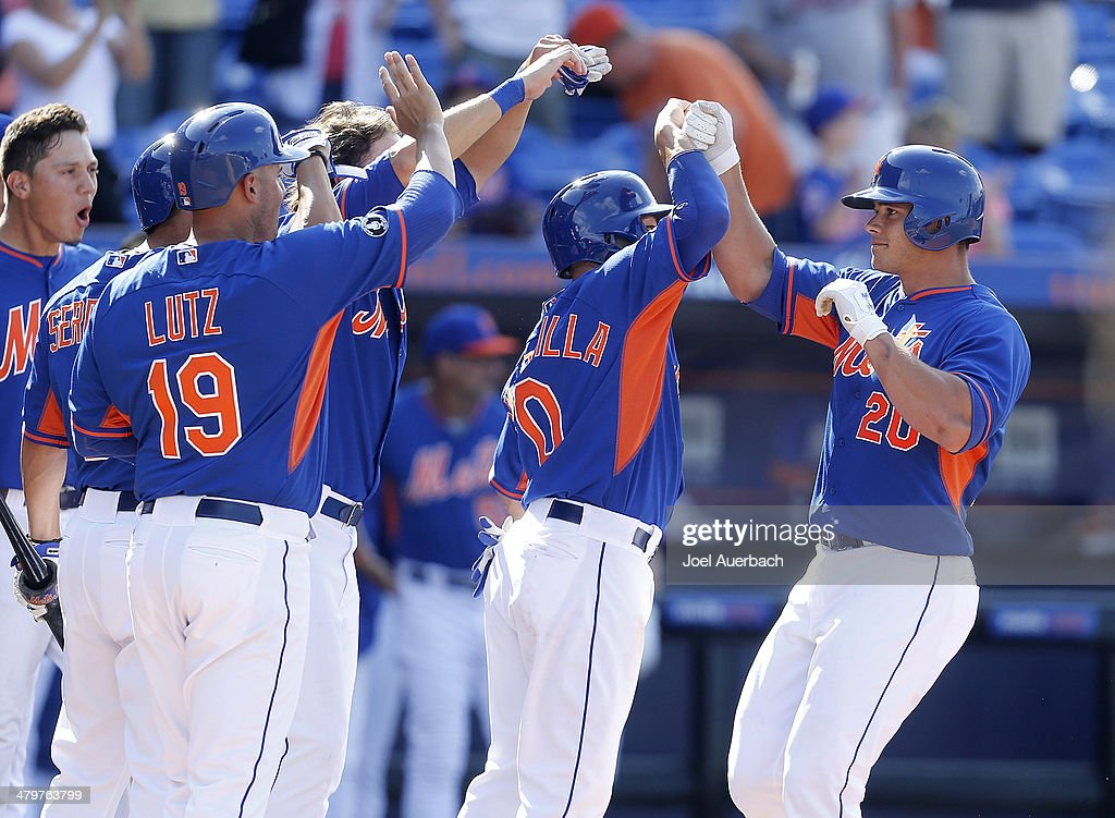 Anthony Recker #20 of the New York Mets is congratulated by teammates after hitting a three-run home run in the bottom of the ninth inning to defeat the Atlanta Braves during a spring training game at Tradition Field on March 20, 2014 in Port St. Lucie, Florida. The Mets defeated the Braves 7-6.