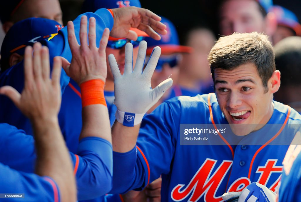 Anthony Recker #20 of the New York Mets is congratulated in the dugout after hitting a two run home run in the fourth inning against the Philadelphia Phillies on August 29, 2013 at Citi Field in the Flushing neighborhood of the Queens borough of New York City.