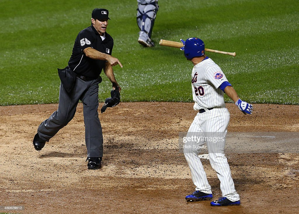 Anthony Recker #20 of the New York Mets is thrown out of the game by home plate umpire Angel Hernandez #55 after being called out on a third strike with the bases loaded in the 11th inning against the Milwaukee Brewers on June 12, 2014 at Citi Field in the Flushing neighborhood of the Queens borough of New York City.