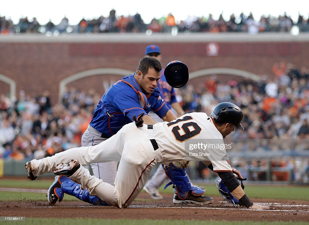 Anthony Recker #20 of the New York Mets tags out <a gi-track='captionPersonalityLinkClicked' href=/galleries/search?phrase=Marco+Scutaro&family=editorial&specificpeople=239523 ng-click='$event.stopPropagation()'>Marco Scutaro</a> #19 of the San Francisco Giants when he tried to score on a hit by Pablo Sandoval #48 in the first inning of their game at AT&T Park on July 9, 2013 in San Francisco, California.