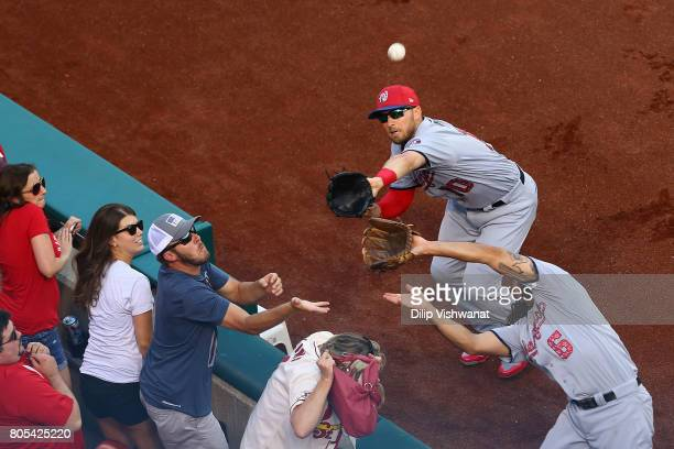 Anthony Rendon and Stephen Drew of the Washington Nationals attempt to catch a pop foul against the St Louis Cardinals in the first inning at Busch...