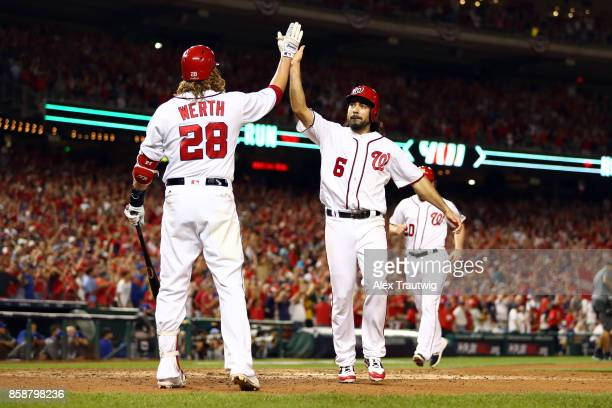 Anthony Rendon celebrates with Jayson Werth after Ryan Zimmerman of the Washington Nationals hit a threerun home run in the eighth inning during Game...