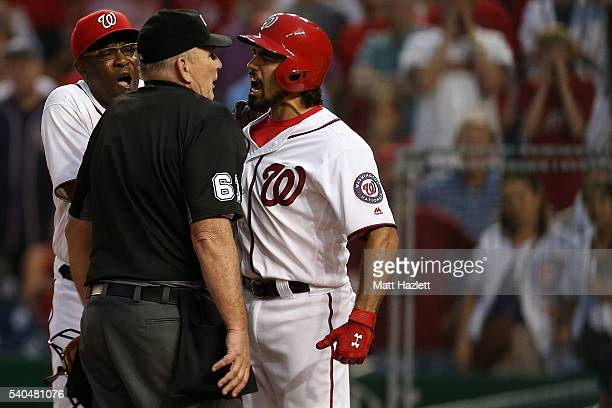 Anthony Rendon of the Washington Nationals and manager Dusty Baker yell at home plate umpire Gerry Davis after Rendon was ejected in the twelfth...