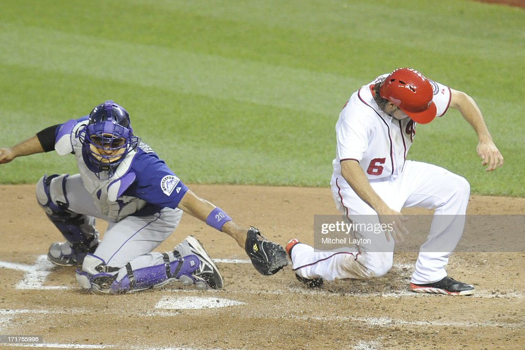 Anthony Rendon #6 of the Washington Nationals beats the tag by <a gi-track='captionPersonalityLinkClicked' href=/galleries/search?phrase=Wilin+Rosario&family=editorial&specificpeople=5734314 ng-click='$event.stopPropagation()'>Wilin Rosario</a> #20 of the Colorado Rockies during a baseball game on June 21, 2013 at Nationals Park in Washington, DC. The Nationals won 2-1.