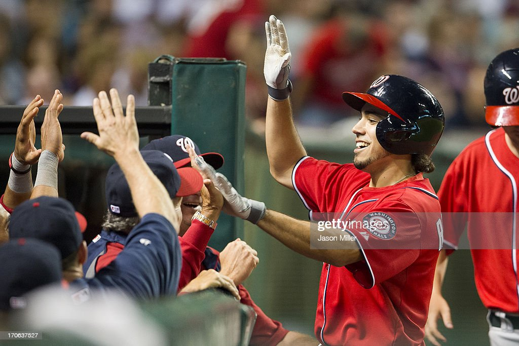 Anthony Rendon #6 of the Washington Nationals celebrates in the dugout after hitting a solo home run during the ninth inning to take the lead over the Cleveland Indians at Progressive Field on June 15, 2013 in Cleveland, Ohio.