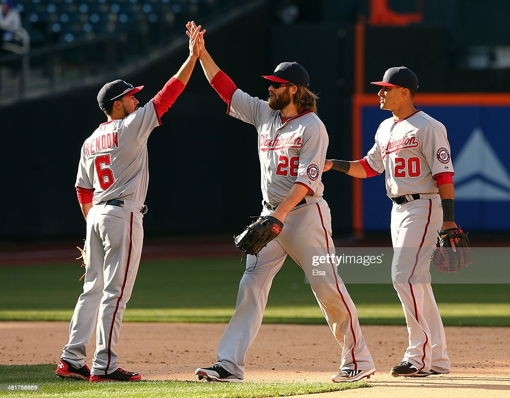 <a gi-track='captionPersonalityLinkClicked' href=/galleries/search?phrase=Anthony+Rendon&family=editorial&specificpeople=7539238 ng-click='$event.stopPropagation()'>Anthony Rendon</a> #6 of the Washington Nationals celebrates the win with teammates <a gi-track='captionPersonalityLinkClicked' href=/galleries/search?phrase=Jayson+Werth&family=editorial&specificpeople=206490 ng-click='$event.stopPropagation()'>Jayson Werth</a> #28 and <a gi-track='captionPersonalityLinkClicked' href=/galleries/search?phrase=Ian+Desmond&family=editorial&specificpeople=835572 ng-click='$event.stopPropagation()'>Ian Desmond</a> #20 during Opening Day on March 31, 2014 at Citi Field in the Flushing neighborhood of the Queens borough of New York City.The Washington Nationals defeated the New York Mets 9-7 in 10 innings.