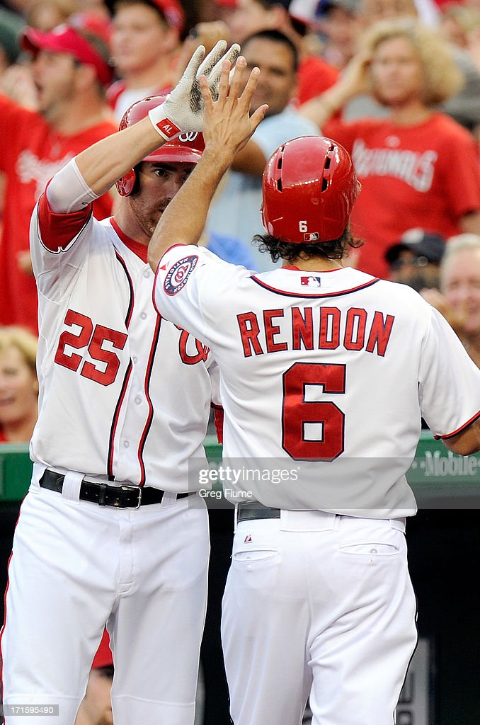 Anthony Rendon #6 of the Washington Nationals celebrates with Adam LaRoche #25 after scoring in the first inning against the Arizona Diamondbacks at Nationals Park on June 26, 2013 in Washington, DC.