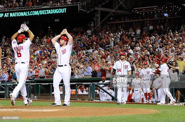 Anthony Rendon of the Washington Nationals celebrates with Daniel Murphy after hitting a threerun home run in the second inning against the New York...