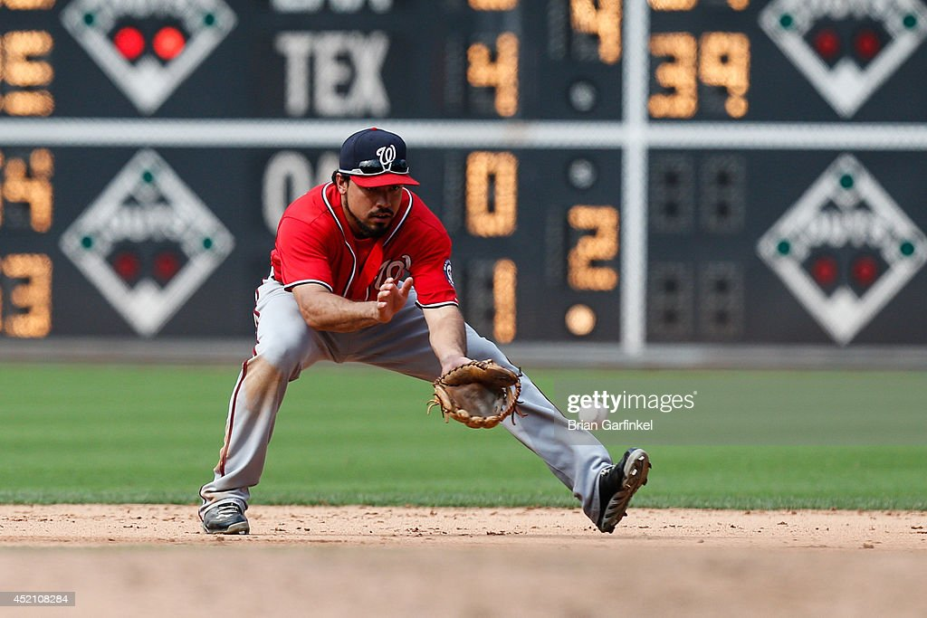 <a gi-track='captionPersonalityLinkClicked' href=/galleries/search?phrase=Anthony+Rendon&family=editorial&specificpeople=7539238 ng-click='$event.stopPropagation()'>Anthony Rendon</a> #6 of the Washington Nationals fields a ground ball in the ninth inning of the game against the Philadelphia Phillies at Citizens Bank Park on July 13, 2014 in Philadelphia, Pennsylvania. The Nationals won 10-3.