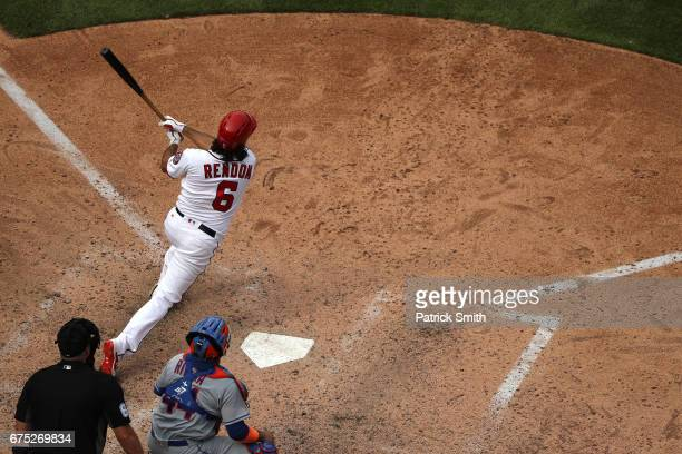 Anthony Rendon of the Washington Nationals follows through on an RBI double that scored three runs during the fifth inning against the New York Mets...