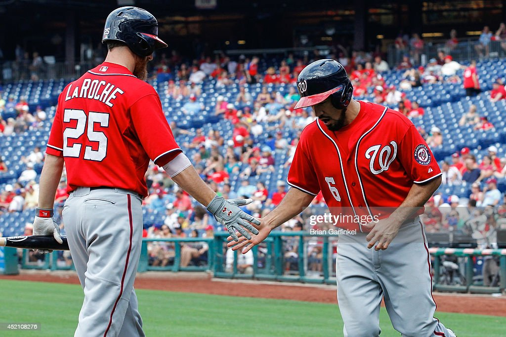 <a gi-track='captionPersonalityLinkClicked' href=/galleries/search?phrase=Anthony+Rendon&family=editorial&specificpeople=7539238 ng-click='$event.stopPropagation()'>Anthony Rendon</a> #6 of the Washington Nationals is congratulated by Adam LaRoche #25 after Rendon scored in the ninth inning of the game against the Philadelphia Phillies at Citizens Bank Park on July 13, 2014 in Philadelphia, Pennsylvania. The Nationals won 10-3.