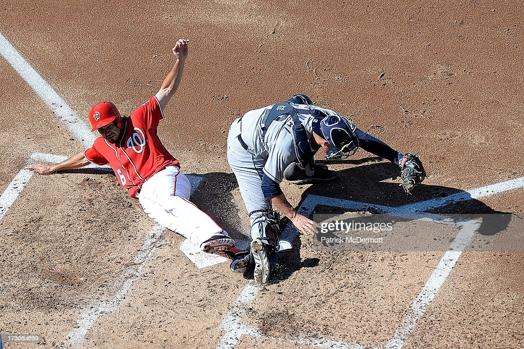 Anthony Rendon #6 of the Washington Nationals is out at home plate as he collides with <a gi-track='captionPersonalityLinkClicked' href=/galleries/search?phrase=Yasmani+Grandal&family=editorial&specificpeople=7510522 ng-click='$event.stopPropagation()'>Yasmani Grandal</a> #12 of the San Diego Padres during the third inning of a game at Nationals Park on July 6, 2013 in Washington, DC. Grandal was forced to leave the game after being injuried on the play.