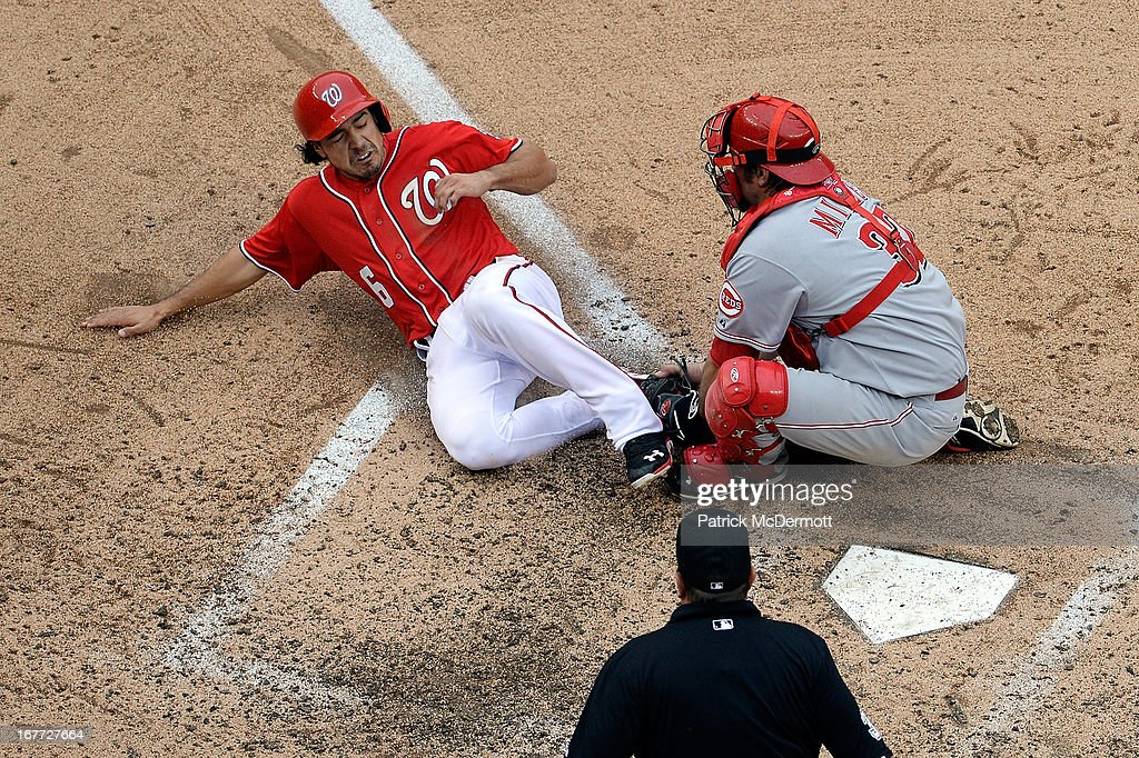 Anthony Rendon #6 of the Washington Nationals is tagged out at home plate by Corky Miller #37 of the Cincinnati Reds to end the fifth inning during a game at Nationals Park on April 28, 2013 in Washington, DC.