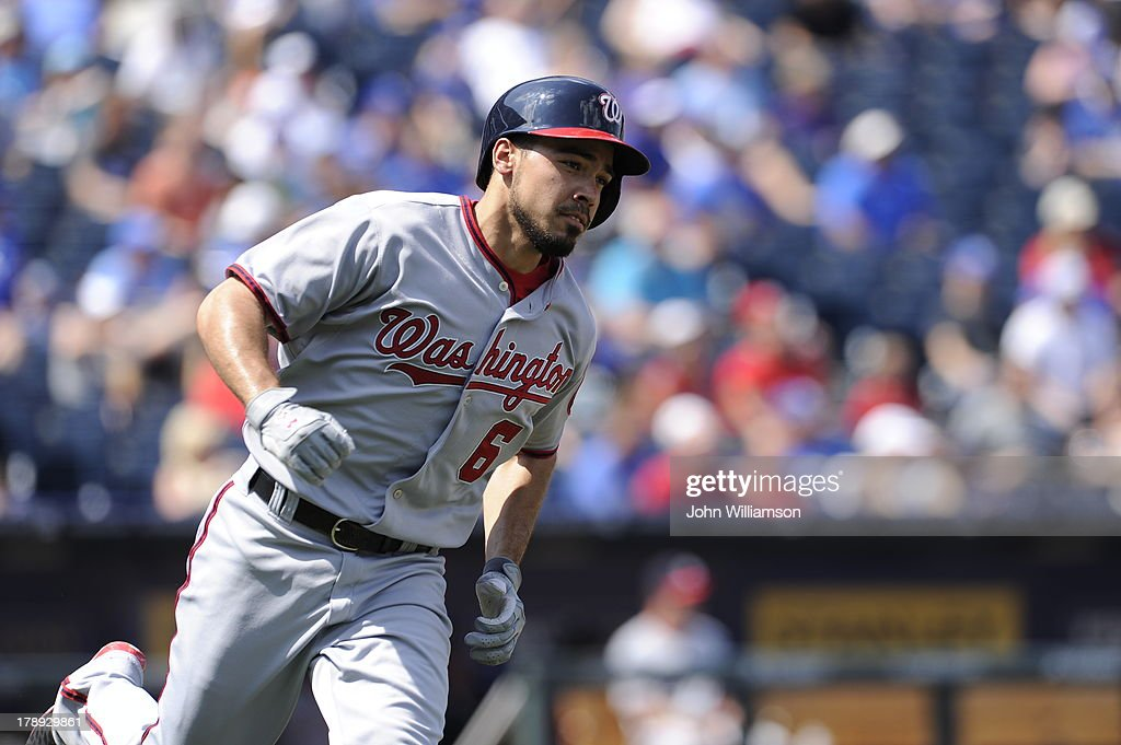 <a gi-track='captionPersonalityLinkClicked' href=/galleries/search?phrase=Anthony+Rendon&family=editorial&specificpeople=7539238 ng-click='$event.stopPropagation()'>Anthony Rendon</a> #6 of the Washington Nationals runs to first base after hitting the ball in the game against the Kansas City Royals on August 25, 2013 at Kauffman Stadium in Kansas City, Missouri. The Kansas City Royals defeated the Washington Nationals 6-4.