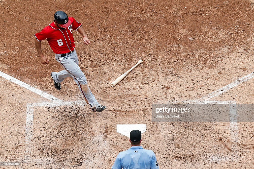<a gi-track='captionPersonalityLinkClicked' href=/galleries/search?phrase=Anthony+Rendon&family=editorial&specificpeople=7539238 ng-click='$event.stopPropagation()'>Anthony Rendon</a> #6 of the Washington Nationals scores a sun in the sixth inning of the game against the Philadelphia Phillies at Citizens Bank Park on July 13, 2014 in Philadelphia, Pennsylvania. The Nationals won 10-3.