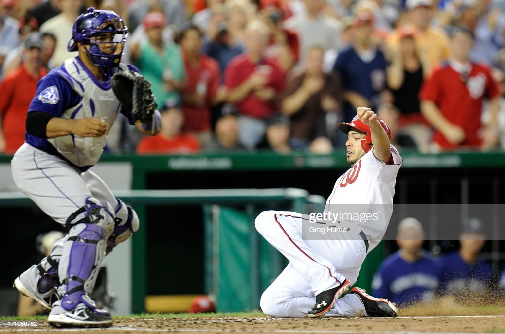 Anthony Rendon #6 of the Washington Nationals scores in the sixth inning ahead of the throw to <a gi-track='captionPersonalityLinkClicked' href=/galleries/search?phrase=Wilin+Rosario&family=editorial&specificpeople=5734314 ng-click='$event.stopPropagation()'>Wilin Rosario</a> #20 of the Colorado Rockies at Nationals Park on June 21, 2013 in Washington, DC. Washington won the game 2-1.