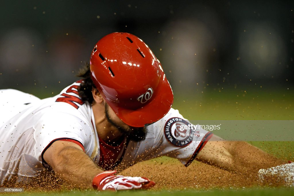 <a gi-track='captionPersonalityLinkClicked' href=/galleries/search?phrase=Anthony+Rendon&family=editorial&specificpeople=7539238 ng-click='$event.stopPropagation()'>Anthony Rendon</a> #6 of the Washington Nationals slides safe for a triple in the eighth inning against the Arizona Diamondbacks at Nationals Park on August 18, 2014 in Washington, DC. The Washington Nationals won, 5-4, in the eleventh inning.