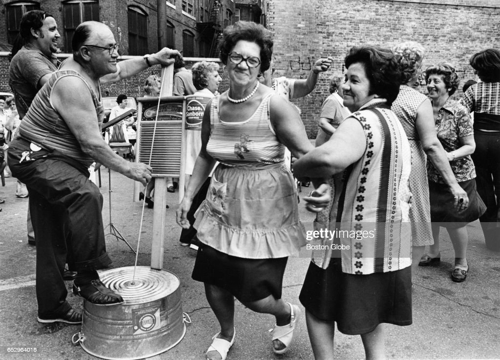 Anthony Reppucci plays the washboard bass while North End residents dance during a Summerthing picnic at the Knights of Columbus in Boston on Jun. 29, 1976.