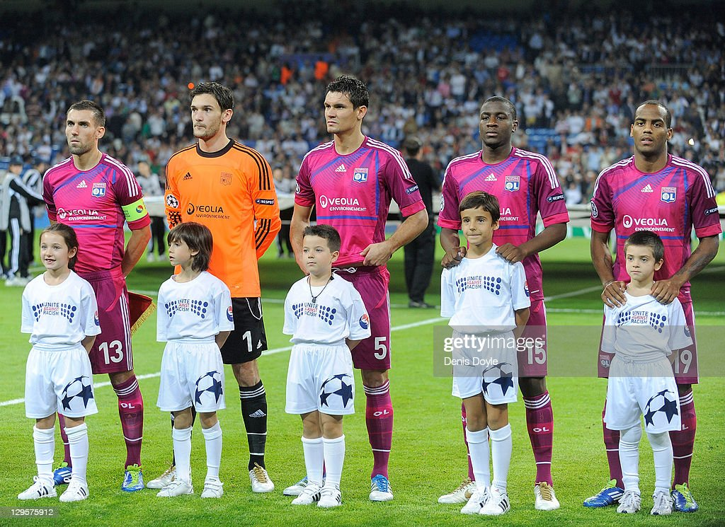 Anthony Reveillere (From L to R.) <a gi-track='captionPersonalityLinkClicked' href=/galleries/search?phrase=Hugo+Lloris&family=editorial&specificpeople=2501893 ng-click='$event.stopPropagation()'>Hugo Lloris</a>, <a gi-track='captionPersonalityLinkClicked' href=/galleries/search?phrase=Dejan+Lovren&family=editorial&specificpeople=5577379 ng-click='$event.stopPropagation()'>Dejan Lovren</a>, Gueida Fofana and <a gi-track='captionPersonalityLinkClicked' href=/galleries/search?phrase=Jimmy+Briand&family=editorial&specificpeople=620315 ng-click='$event.stopPropagation()'>Jimmy Briand</a> of Olympique Lyonnais line-up before the start of the UEFA Champions League Group D match between Real Madrid CF and Olympique Lyonnais at Estadio Santiago Bernabeu on October 18, 2011 in Madrid, Spain.