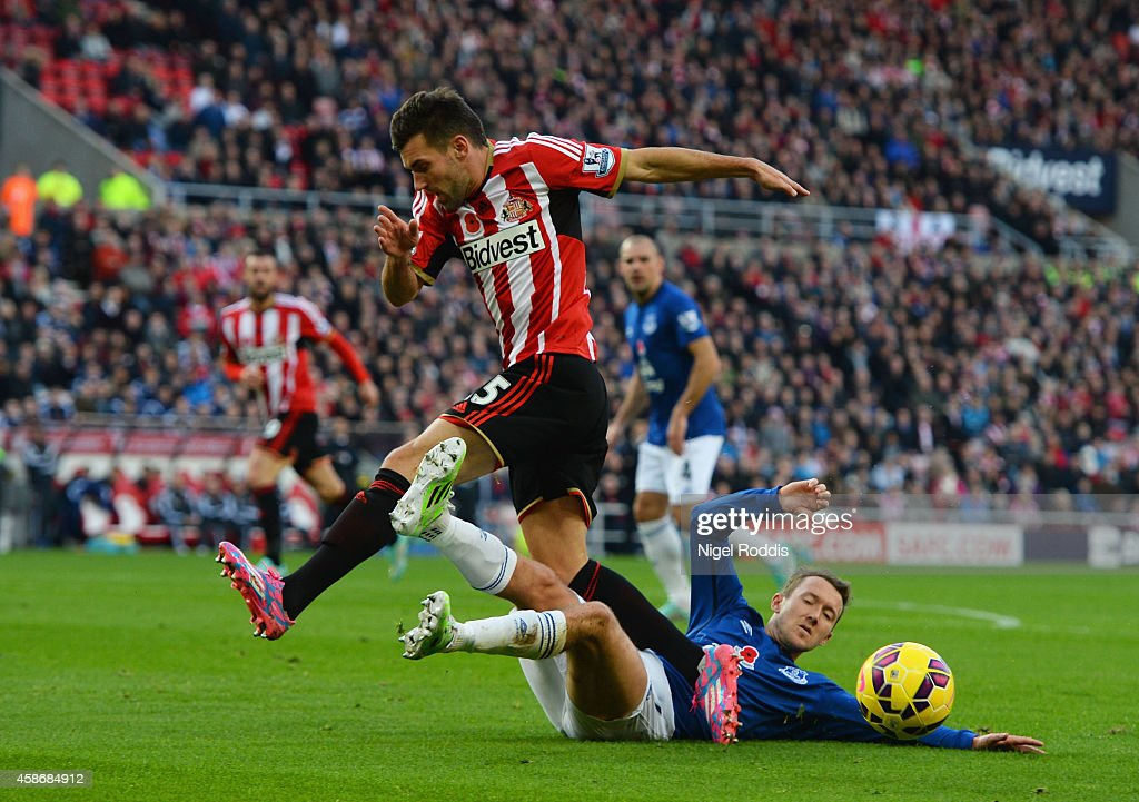 Anthony Reveillere of Sunderland is tackled by Aidan McGeady of Everton during the Barclays Premier League match between Sunderland and Everton at Stadium of Light on November 9, 2014 in Sunderland, England.