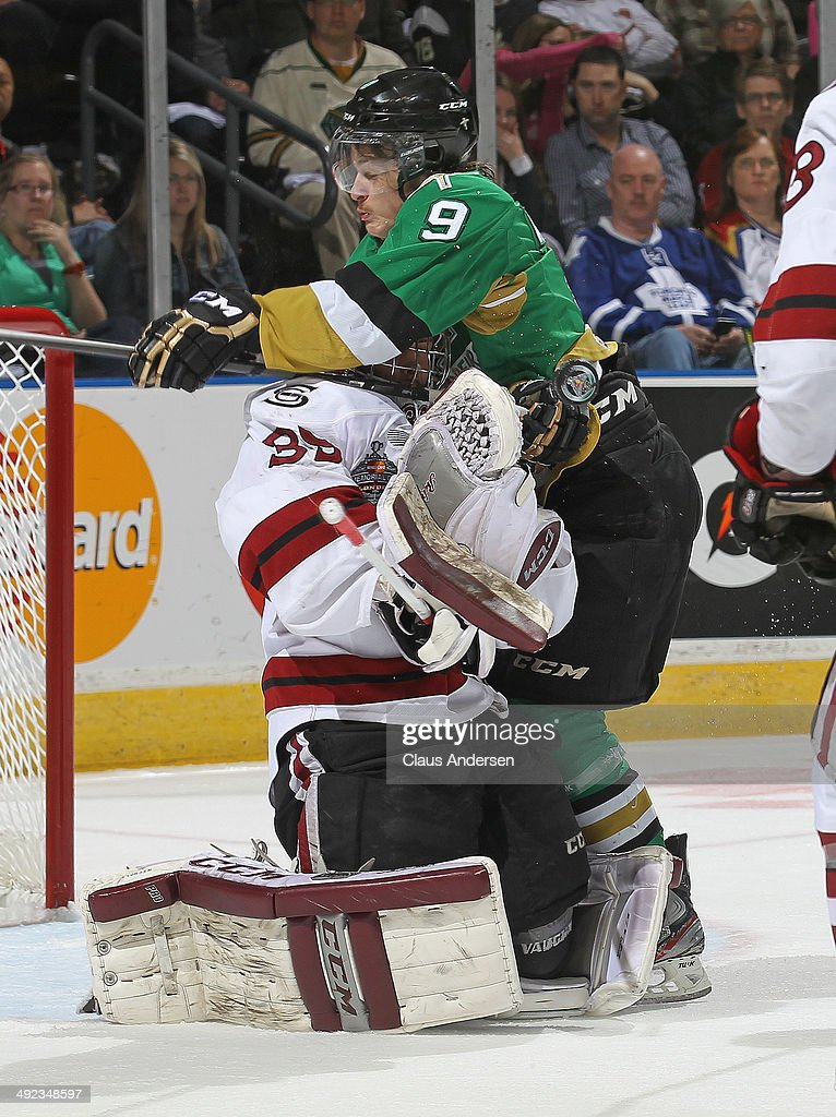 Anthony Richard #9 of the Val'Dor Foreurs slams into Justin Nichols #39 of the Guelph Storm drawing a penalty in Game Four of the 2014 MasterCard Memorial Cup at Budweiser Gardens on May 19, 2014 in London, Ontario, Canada.