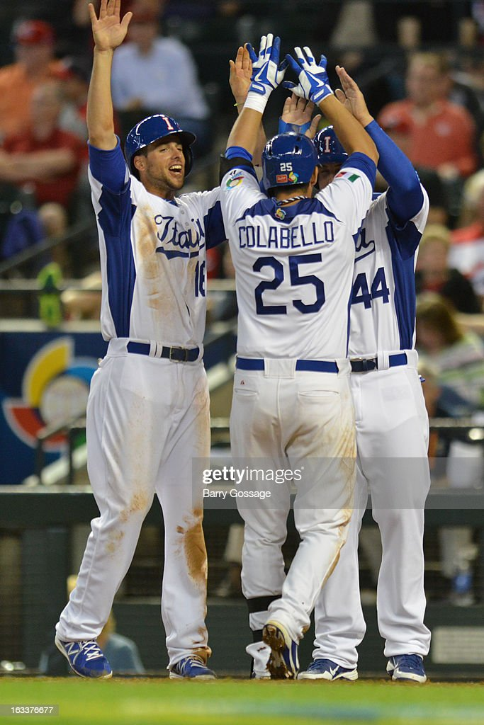 Anthony Rizzo #44 and Alex Liddi #16 of Team Italy greet teammate Chris Colabello #25 at the plate after his three-run home run in the bottom of the third inning of Pool D, Game 2 between Team Canada and Team Italy at Chase Field on Friday, March 8, 2013 in Phoenix, Arizona.