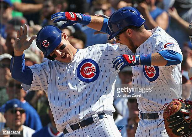 Anthony Rizzo and Ben Zobrist of the Chicago Cubs celebrate Zobrist's three run home run in the 5th inning against the Washington Nationals at...