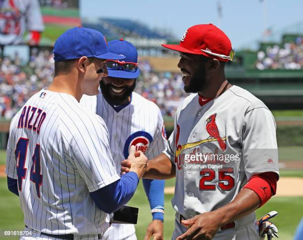 Anthony Rizzo and Jason Heyward of the Chicago Cubs greet Dexter Fowler of the St Louis Cardinals and present him with his World Series ring before a...