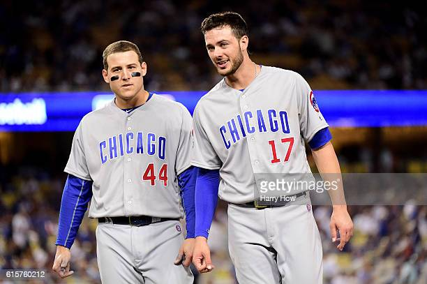 Anthony Rizzo and Kris Bryant of the Chicago Cubs look on in the eighth inning against the Los Angeles Dodgers in game four of the National League...
