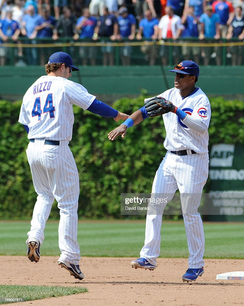 <a gi-track='captionPersonalityLinkClicked' href=/galleries/search?phrase=Anthony+Rizzo&family=editorial&specificpeople=7551494 ng-click='$event.stopPropagation()'>Anthony Rizzo</a> #44 and <a gi-track='captionPersonalityLinkClicked' href=/galleries/search?phrase=Starlin+Castro&family=editorial&specificpeople=5970945 ng-click='$event.stopPropagation()'>Starlin Castro</a> #13 of the Chicago Cubs celebrate their win against the New York Mets on May 18, 2013 at Wrigley Field in Chicago, Illinois. The Chicago Cubs defeated New York Mets 8-2.