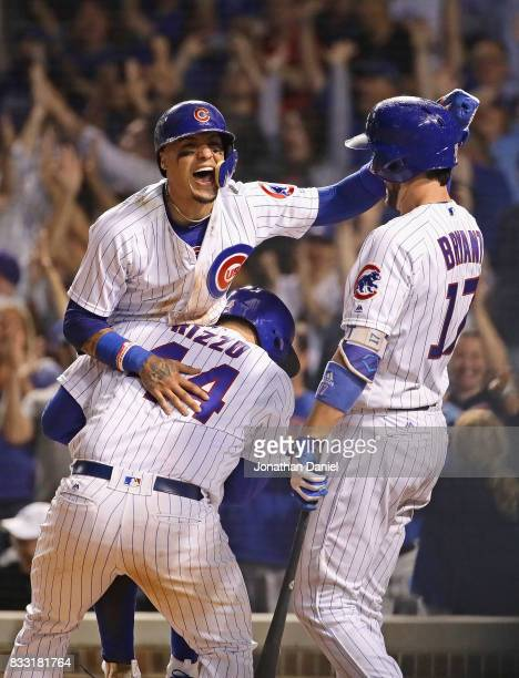 Anthony Rizzo Javier Baez and Kris Bryant of the Chicago Cubs celebrate after Baez scored the winning run on a wild pitch in the bottom of the 9th...